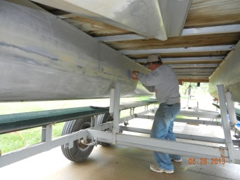 applying SteelFlex epoxy coating to pontoons