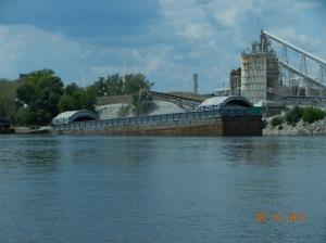 barge being loaded, probably fertilizer