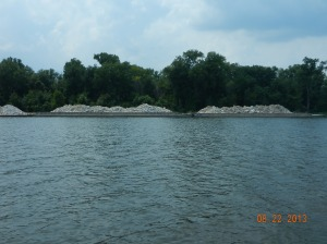 Large rock on barges, ready to be placed