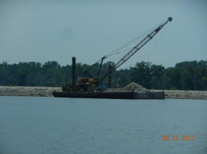 machine placing rock for channel stablization