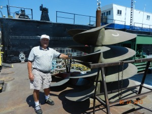 Milt next to a pile of towboat propellers,  we did not even try to lift one.
