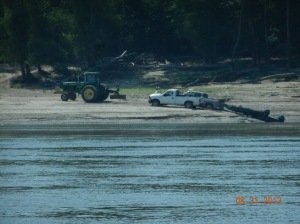 pickup trying to get boat pulled out using a sandbar for ramp.  had to get a tractor to pull pickup