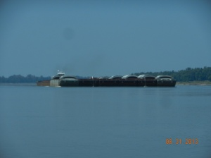 Meeting a huge barge, tow pushing 20 or 24 barges.  we called him and he advised meeting on right sides, next to red buoys.