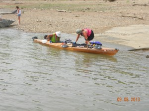 Barb and Gene  Geiger with their wooden kayak, made from a kit and traveling about 2000 miles and doing volunteer service work along the way.