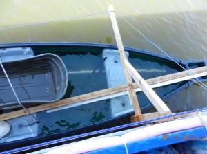 Canoe fulll of water from waves splashing over side