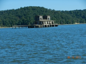 This old structure appears to be setting in several feet of water,  must have been some sort of building  along the river that was left and flooded when they created the lake.
